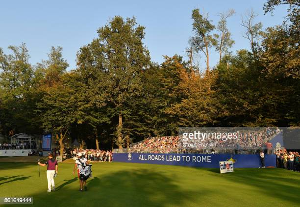 Tyrrell Hatton of England waves to fans on the 18th hole during the final round of The Italian Open at Golf Club Milano Parco Reale di Monza on...