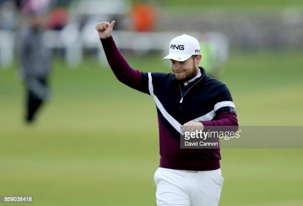 Tyrrell Hatton of England waves to the crowds on the 18th hole during the final round of the 2017 Alfred Dunhill Links Championship on the Old Course...