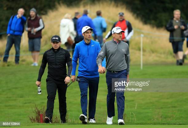 Tyrell Hatton Ross Fisher and Ian Poulter of England walk up the 14th hole during day two of the British Masters at Close House Golf Club on...