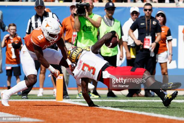 Tyrrell Pigrome of the Maryland Terrapins scores a touchdown in the first quarter defended by Kris Boyd of the Texas Longhorns at Darrell K...