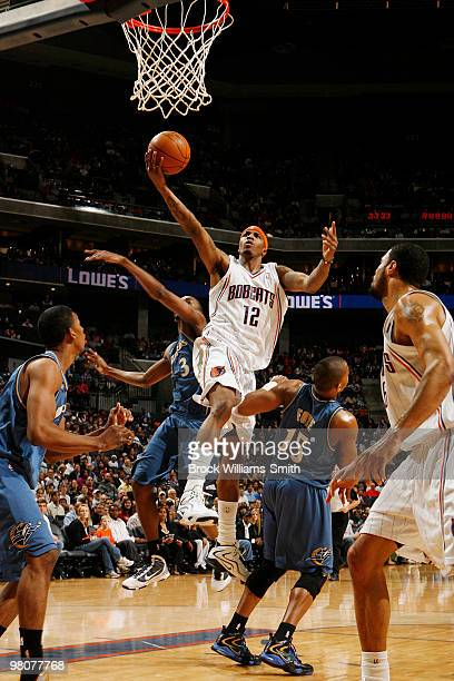 Tyrus Thomas of the Charlotte Bobcats goes for the layup against Randy Foye of the Washington Wizards on March 26 2010 at the Time Warner Cable Arena...