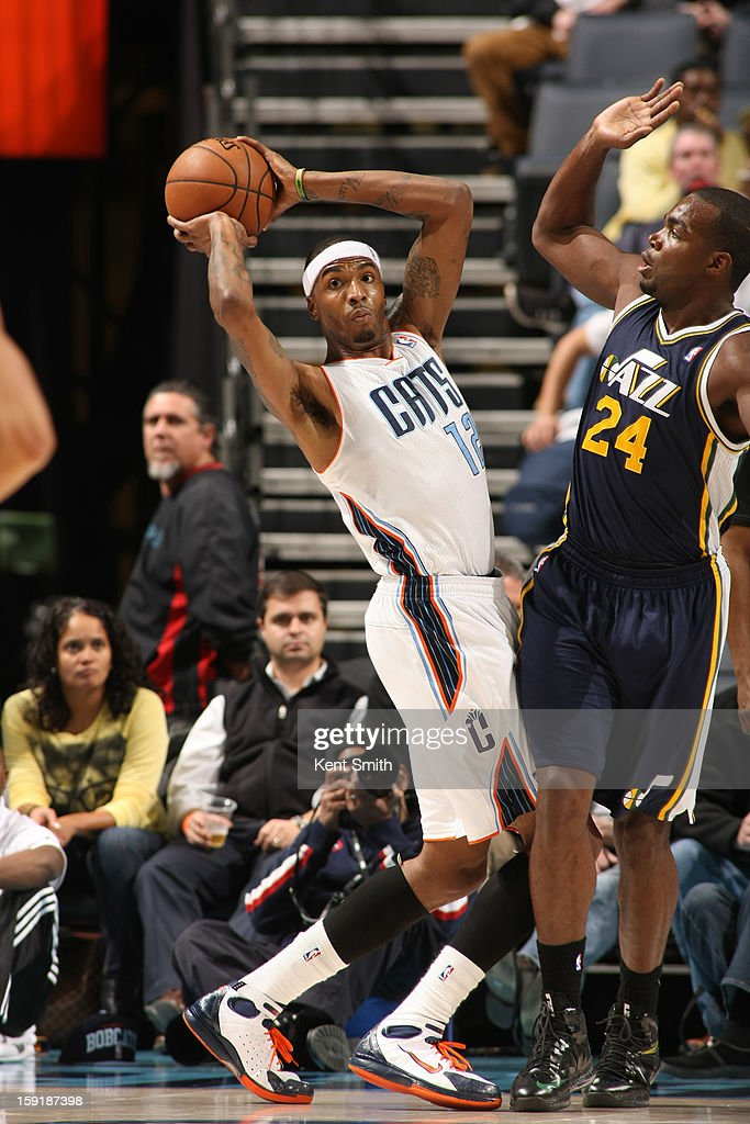 Tyrus Thomas #12 of the Charlotte Bobcats passes against Paul Millsap #24 of the Utah Jazz at the Time Warner Cable Arena on January 9, 2013 in Charlotte, North Carolina.