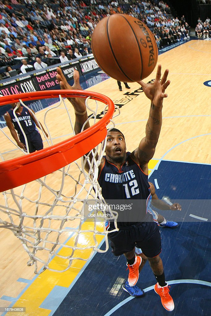 <a gi-track='captionPersonalityLinkClicked' href=/galleries/search?phrase=Tyrus+Thomas&family=editorial&specificpeople=453285 ng-click='$event.stopPropagation()'>Tyrus Thomas</a> #12 of the Charlotte Bobcats reaches for a rebound against the Memphis Grizzlies on April 9, 2013 at FedExForum in Memphis, Tennessee.