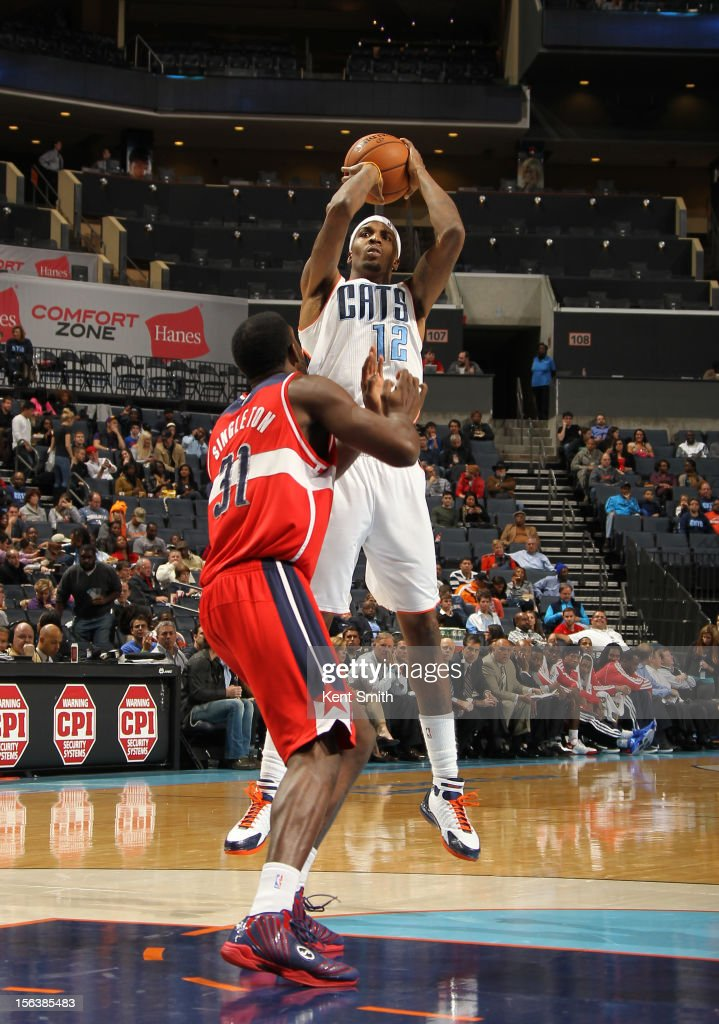 <a gi-track='captionPersonalityLinkClicked' href=/galleries/search?phrase=Tyrus+Thomas&family=editorial&specificpeople=453285 ng-click='$event.stopPropagation()'>Tyrus Thomas</a> #12 of the Charlotte Bobcats shoots against <a gi-track='captionPersonalityLinkClicked' href=/galleries/search?phrase=Chris+Singleton&family=editorial&specificpeople=241555 ng-click='$event.stopPropagation()'>Chris Singleton</a> #31 of the Washington Wizards at the Time Warner Cable Arena on November 13, 2012 in Charlotte, North Carolina.