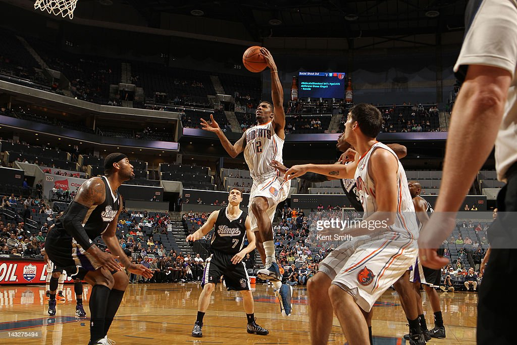 <a gi-track='captionPersonalityLinkClicked' href=/galleries/search?phrase=Tyrus+Thomas&family=editorial&specificpeople=453285 ng-click='$event.stopPropagation()'>Tyrus Thomas</a> #12 of the Charlotte Bobcats shoots against the Sacramento Kings at the Time Warner Cable Arena on April 22, 2012 in Charlotte, North Carolina.