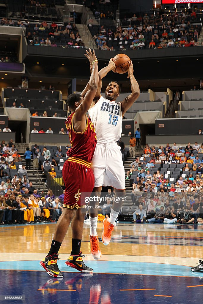 Tyrus Thomas #12 of the Charlotte Bobcats shoots against Tristan Thompson #13 of the Cleveland Cavaliers at the Time Warner Cable Arena on April 17, 2013 in Charlotte, North Carolina.