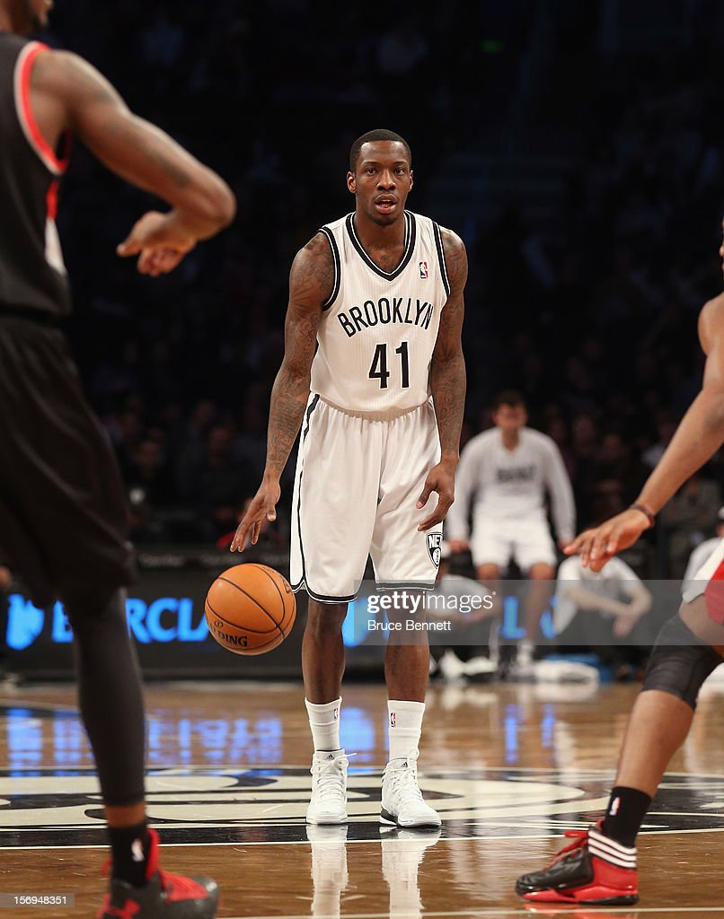 Tyshawn Taylor #41 dribbles the ball against the Portland Trail Blazers at the Barclays Center on November 25, 2012 in the Brooklyn borough of New York City.