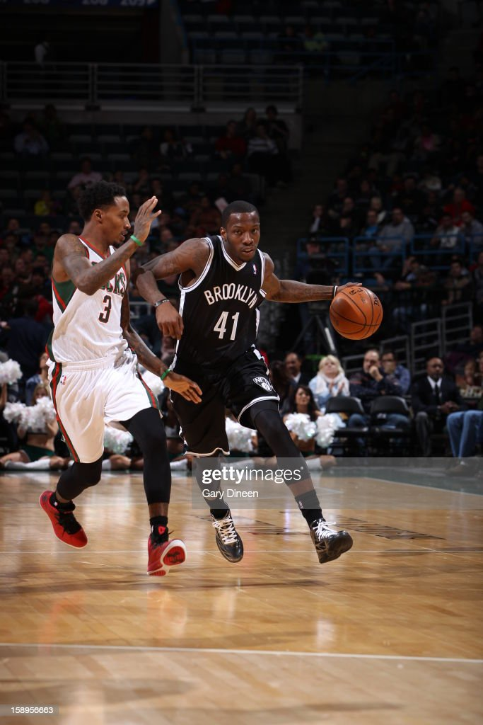 <a gi-track='captionPersonalityLinkClicked' href=/galleries/search?phrase=Tyshawn+Taylor&family=editorial&specificpeople=5619738 ng-click='$event.stopPropagation()'>Tyshawn Taylor</a> #41 of the Brooklyn Nets brings the ball up court against the Milwaukee Bucks on December 26, 2012 at the BMO Harris Bradley Center in Milwaukee, Wisconsin.