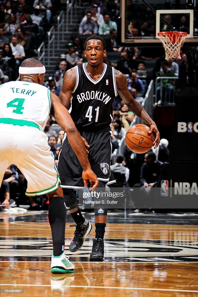 <a gi-track='captionPersonalityLinkClicked' href=/galleries/search?phrase=Tyshawn+Taylor&family=editorial&specificpeople=5619738 ng-click='$event.stopPropagation()'>Tyshawn Taylor</a> #41 of the Brooklyn Nets controls the ball against <a gi-track='captionPersonalityLinkClicked' href=/galleries/search?phrase=Jason+Terry&family=editorial&specificpeople=201734 ng-click='$event.stopPropagation()'>Jason Terry</a> #4 of the Boston Celtics during a pre-season game on October 18, 2012 at the Barclays Center in the Brooklyn borough of New York City.