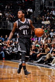 Tyshawn Taylor of the Brooklyn Nets controls the ball against the Boston Celtics during a preseason game on October 18 2012 at the Barclays Center in...