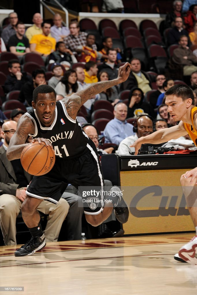 <a gi-track='captionPersonalityLinkClicked' href=/galleries/search?phrase=Tyshawn+Taylor&family=editorial&specificpeople=5619738 ng-click='$event.stopPropagation()'>Tyshawn Taylor</a> #41 of the Brooklyn Nets drives against Chris Quinn #20 of the Cleveland Cavaliers at The Quicken Loans Arena on April 3, 2013 in Cleveland, Ohio.