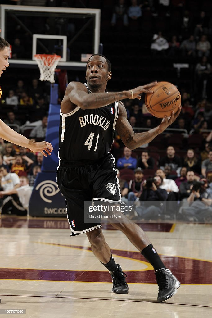 <a gi-track='captionPersonalityLinkClicked' href=/galleries/search?phrase=Tyshawn+Taylor&family=editorial&specificpeople=5619738 ng-click='$event.stopPropagation()'>Tyshawn Taylor</a> #41 of the Brooklyn Nets drives against the Cleveland Cavaliers at The Quicken Loans Arena on April 3, 2013 in Cleveland, Ohio.