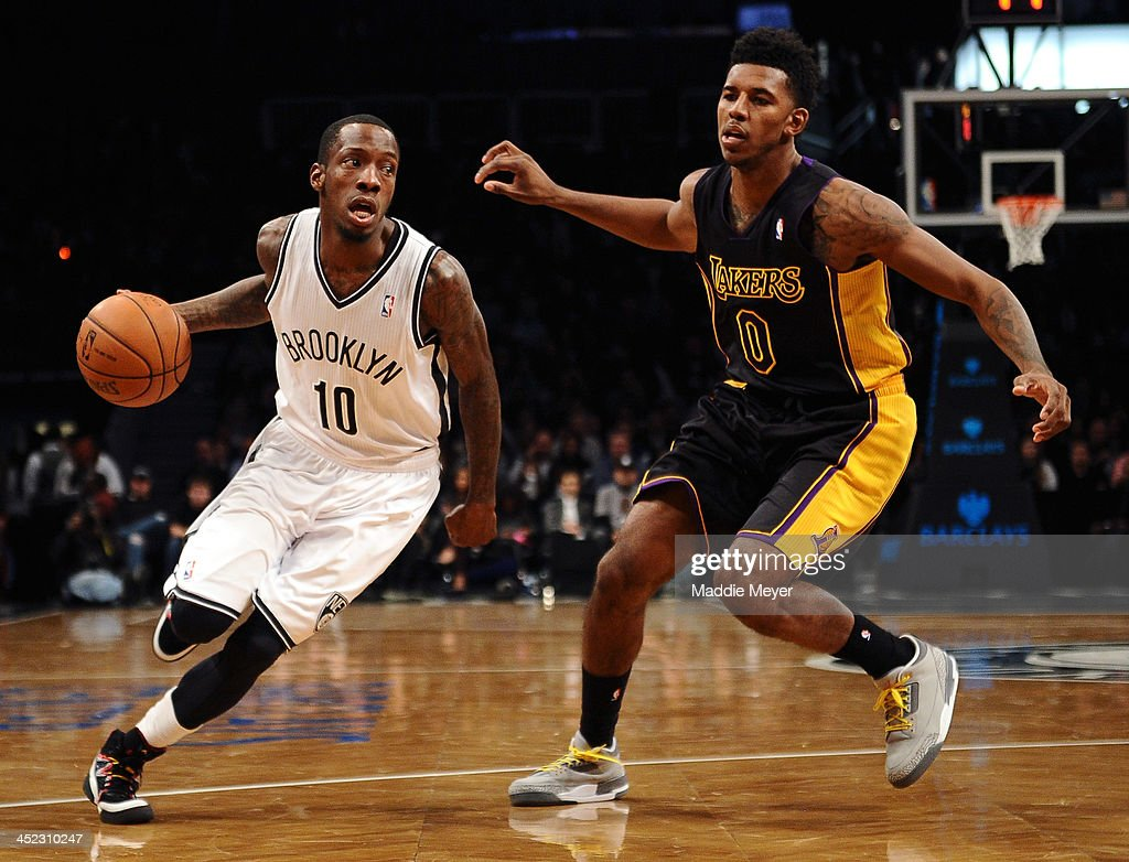 <a gi-track='captionPersonalityLinkClicked' href=/galleries/search?phrase=Tyshawn+Taylor&family=editorial&specificpeople=5619738 ng-click='$event.stopPropagation()'>Tyshawn Taylor</a> #10 of the Brooklyn Nets drives past Nick Young #0 of the Los Angeles Lakers during the second half at Barclays Center on November 27, 2013 in the Brooklyn borough of New York City. The Lakers defeat the Nets 99-94.