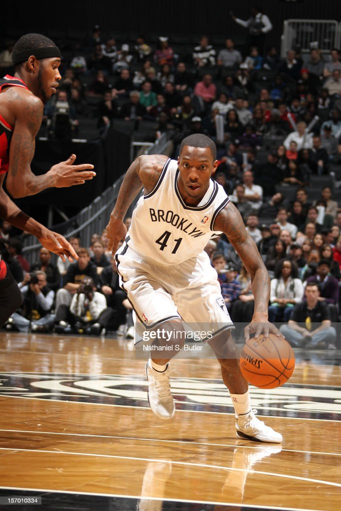 <a gi-track='captionPersonalityLinkClicked' href=/galleries/search?phrase=Tyshawn+Taylor&family=editorial&specificpeople=5619738 ng-click='$event.stopPropagation()'>Tyshawn Taylor</a> #41 of the Brooklyn Nets drives to the basket against the Portland Trail Blazers on November 25, 2012 at the Barclays Center in the Brooklyn Borough of New York City.