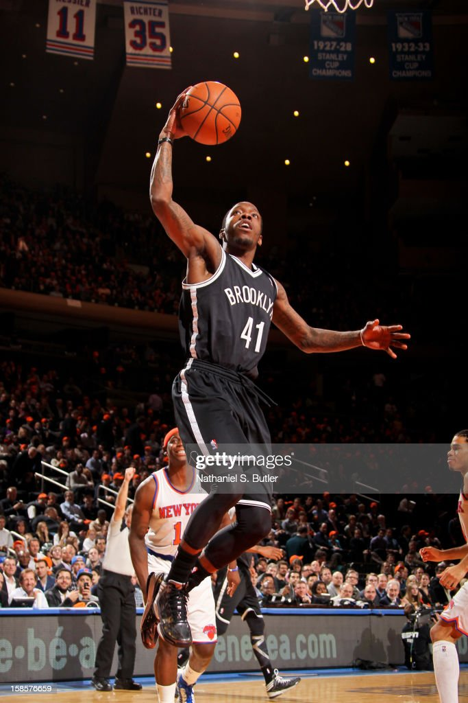 Tyshawn Taylor #41 of the Brooklyn Nets drives to the basket against the New York Knicks on December 19, 2012 at Madison Square Garden in New York City.
