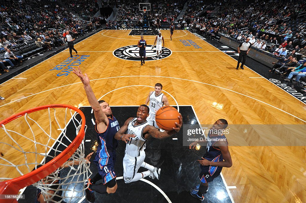 Tyshawn Taylor #41 of the Brooklyn Nets drives to the basket against the Charlotte Bobcats during the game at the Barclays Center on December 28, 2012 in Brooklyn, New York.