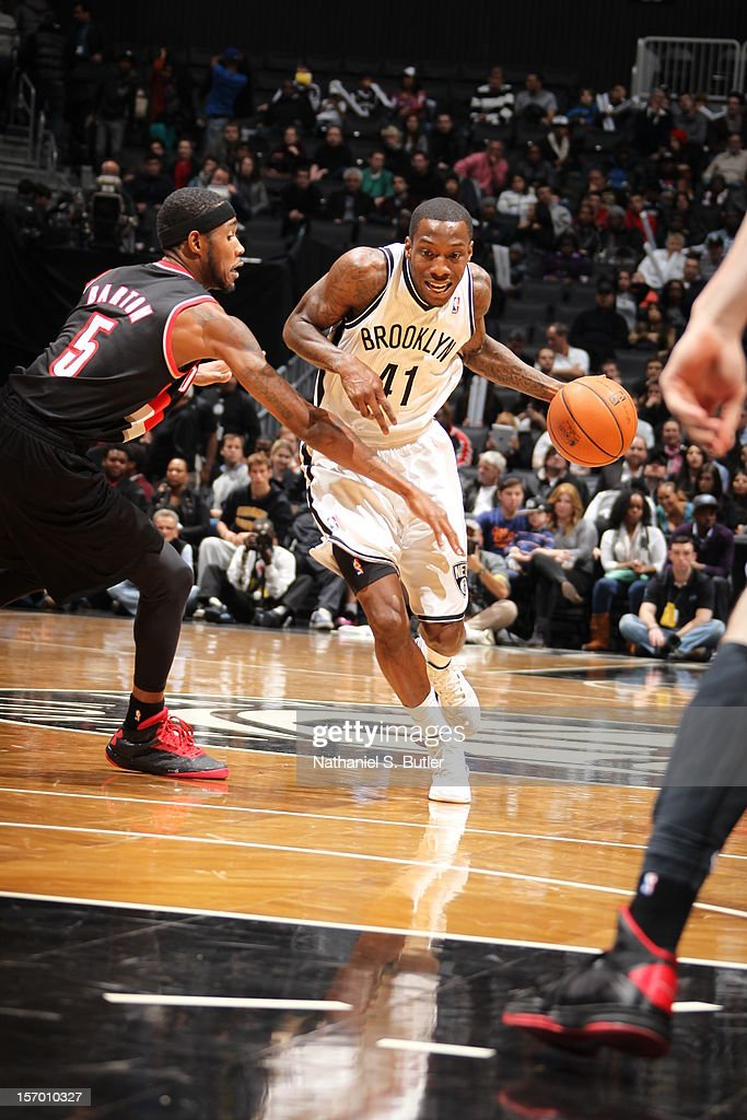 <a gi-track='captionPersonalityLinkClicked' href=/galleries/search?phrase=Tyshawn+Taylor&family=editorial&specificpeople=5619738 ng-click='$event.stopPropagation()'>Tyshawn Taylor</a> #41 of the Brooklyn Nets drives to the basket around <a gi-track='captionPersonalityLinkClicked' href=/galleries/search?phrase=Will+Barton&family=editorial&specificpeople=6894020 ng-click='$event.stopPropagation()'>Will Barton</a> #5 of the Portland Trail Blazers on November 25, 2012 at the Barclays Center in the Brooklyn Borough of New York City.