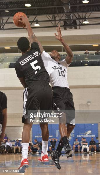 Tyshawn Taylor of the Brooklyn Nets goes to the basket against Kentavious CaldwellPope of the Detroit Pistons during the 2013 Southwest Airlines...