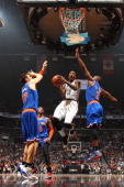 Tyshawn Taylor of the Brooklyn Nets goes up to shoot against the New York Knicks during a game at Barclays Center on December 5 2013 in the Brooklyn...