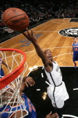 Tyshawn Taylor of the Brooklyn Nets goes up to shoot during a game against the New York Knicks at Barclays Center on December 5 2013 in the Brooklyn...