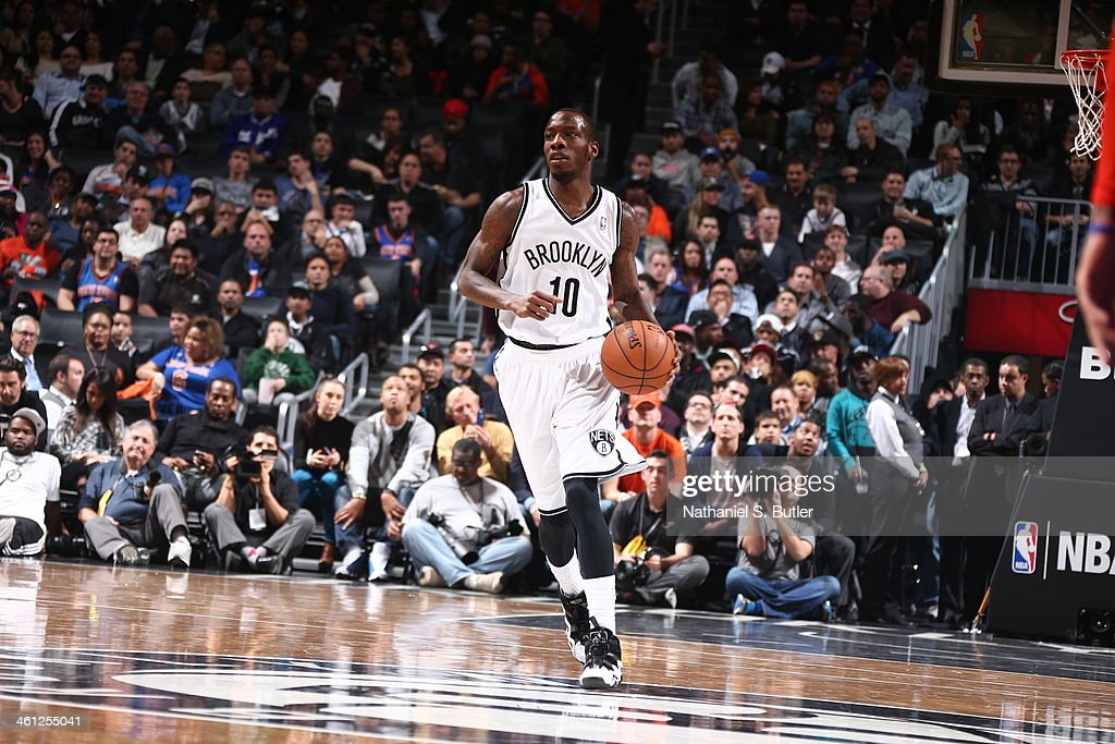 <a gi-track='captionPersonalityLinkClicked' href=/galleries/search?phrase=Tyshawn+Taylor&family=editorial&specificpeople=5619738 ng-click='$event.stopPropagation()'>Tyshawn Taylor</a> #10 of the Brooklyn Nets handling the ball during a game agasint the New York Knicks during a game at Barclays Center on December 5, 2013 in the Brooklyn borough of New York City.