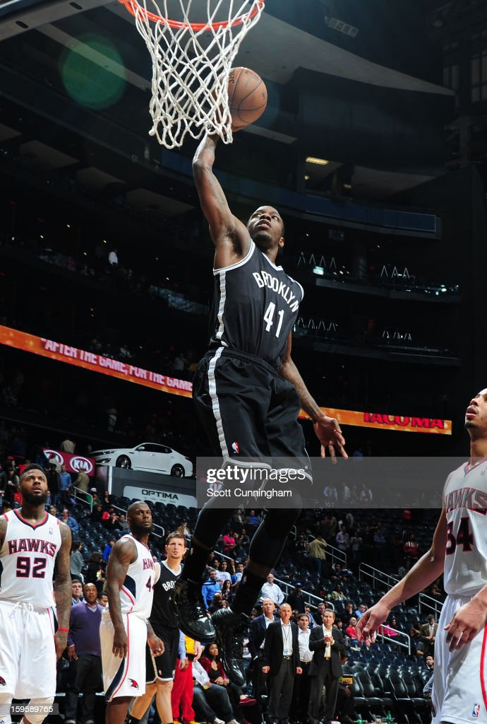 <a gi-track='captionPersonalityLinkClicked' href=/galleries/search?phrase=Tyshawn+Taylor&family=editorial&specificpeople=5619738 ng-click='$event.stopPropagation()'>Tyshawn Taylor</a> #41 of the Brooklyn Nets rises for a dunk against the Atlanta Hawks on January 16, 2013 at Philips Arena in Atlanta, Georgia.