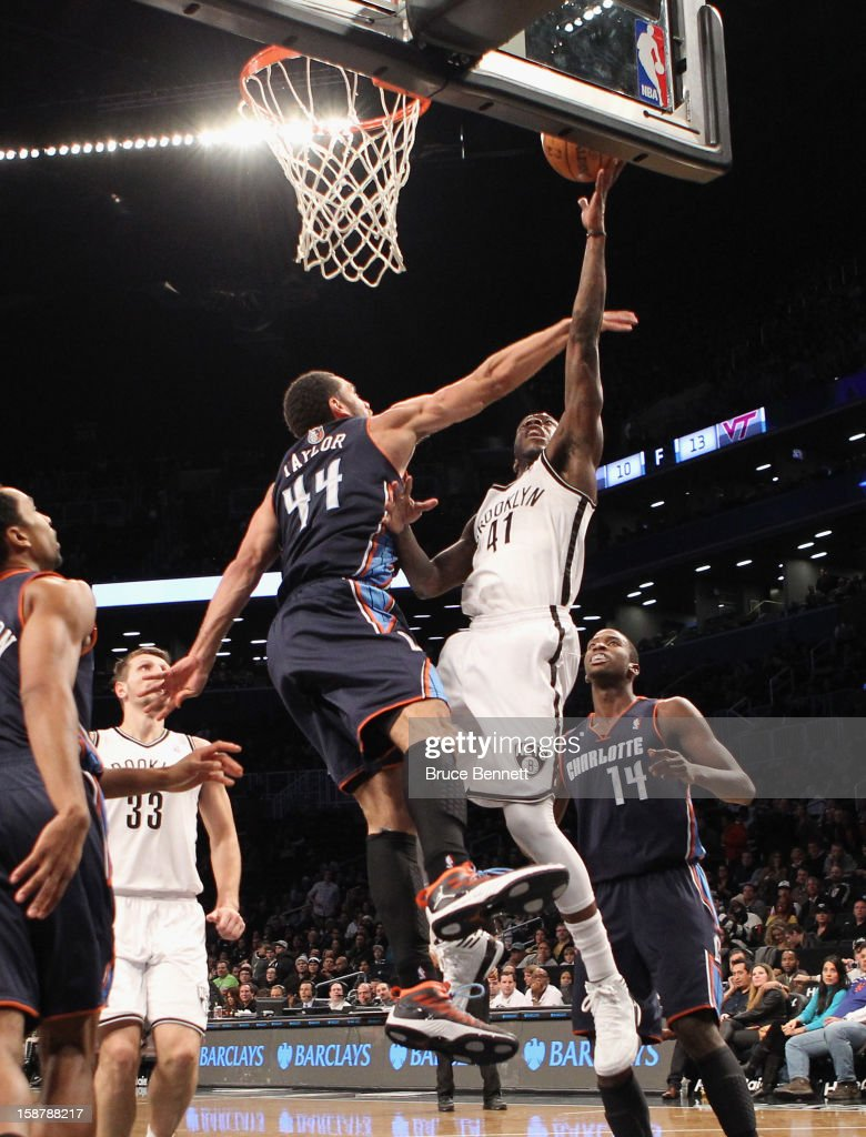 Tyshawn Taylor #41 of the Brooklyn Nets scores two in the fourth quarter against Jeffery Taylor #44 of the Charlotte Bobcats at the Barclays Center on December 28, 2012 in the Brooklyn borough of New York City.