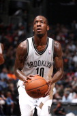 Tyshawn Taylor of the Brooklyn Nets shoots a free throw against the Denver Nuggets on December 3 2013 in the Brooklyn borough of New York City at...