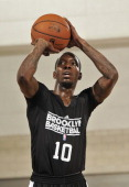 Tyshawn Taylor of the Brooklyn Nets shoots a free throw during the 2013 Southwest Airlines Orlando Pro Summer League game between the Brooklyn Nets...