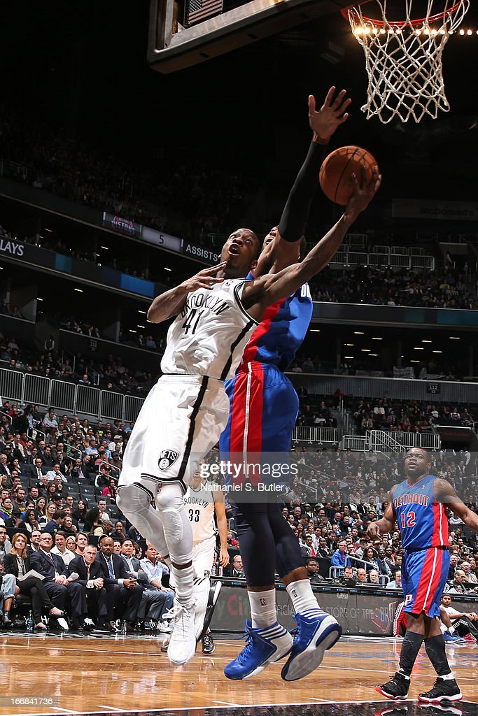Tyshawn Taylor #41 of the Brooklyn Nets shoots against Andre Drummond #1 of the Detroit Pistons on April 17, 2013 at the Barclays Center in the Brooklyn borough of New York City.