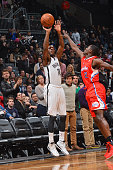 Tyshawn Taylor of the Brooklyn Nets shoots against Darren Collison of the Los Angeles Clippers on December 12 2013 at the Barclays Center in Brooklyn...