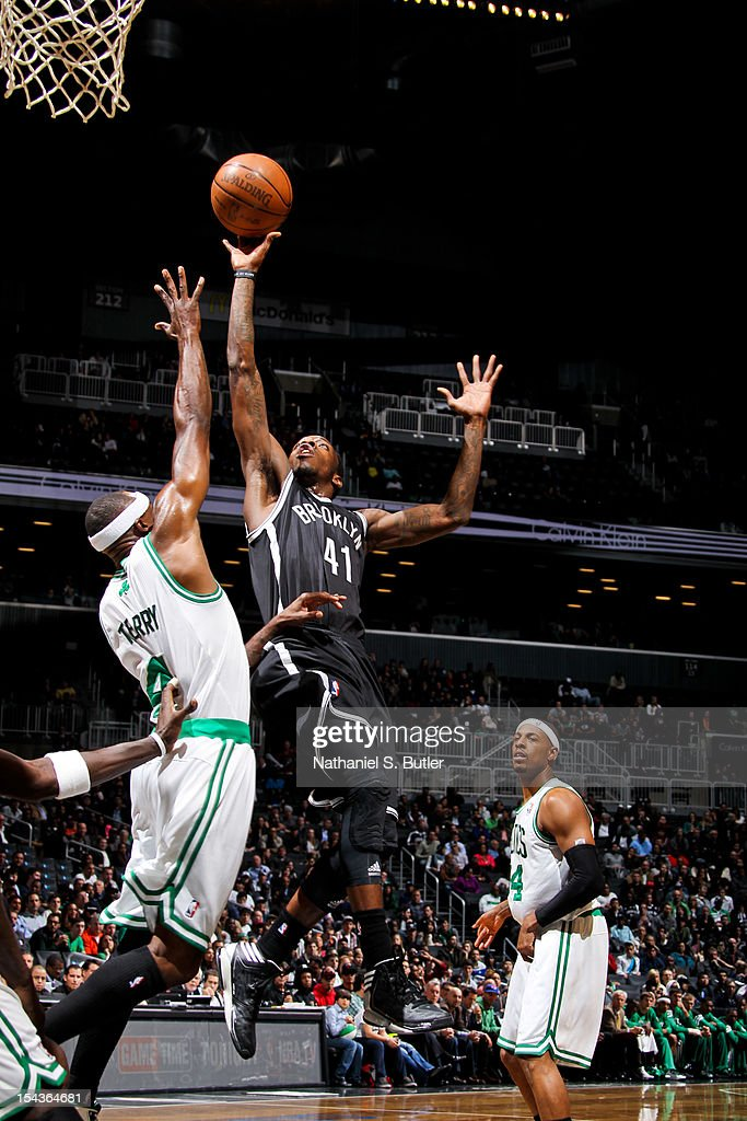 <a gi-track='captionPersonalityLinkClicked' href=/galleries/search?phrase=Tyshawn+Taylor&family=editorial&specificpeople=5619738 ng-click='$event.stopPropagation()'>Tyshawn Taylor</a> #41 of the Brooklyn Nets shoots against <a gi-track='captionPersonalityLinkClicked' href=/galleries/search?phrase=Jason+Terry&family=editorial&specificpeople=201734 ng-click='$event.stopPropagation()'>Jason Terry</a> #4 of the Boston Celtics during a pre-season game on October 18, 2012 at the Barclays Center in the Brooklyn borough of New York City.