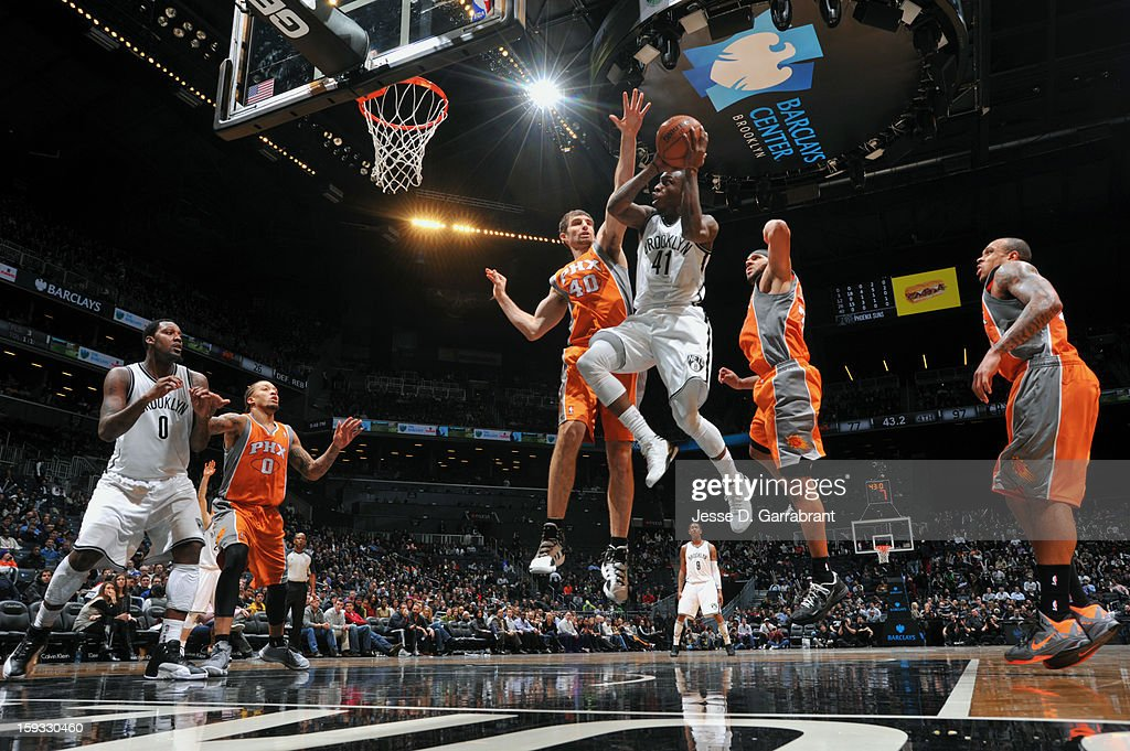 Tyshawn Taylor #41 of the Brooklyn Nets shoots against Luke Zeller #40 Phoenix Suns during the game at the Barclays Center on January 11, 2013 in Brooklyn, New York.