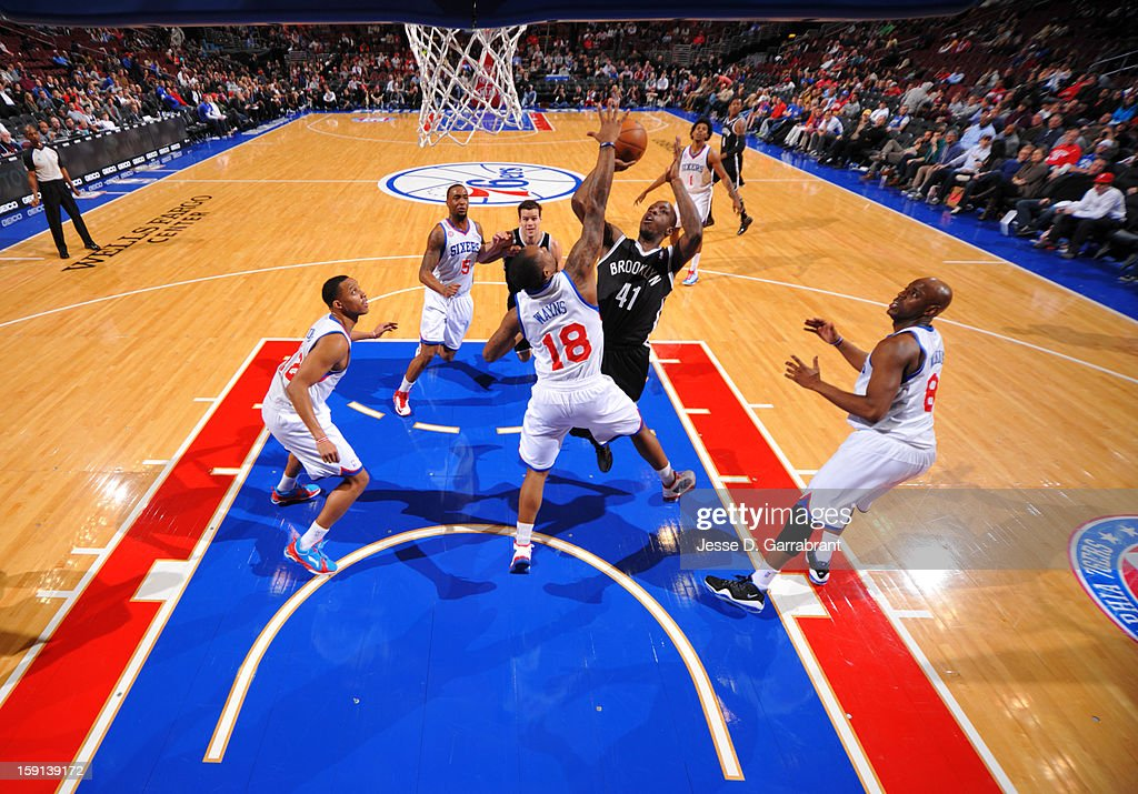 <a gi-track='captionPersonalityLinkClicked' href=/galleries/search?phrase=Tyshawn+Taylor&family=editorial&specificpeople=5619738 ng-click='$event.stopPropagation()'>Tyshawn Taylor</a> #41 of the Brooklyn Nets shoots against <a gi-track='captionPersonalityLinkClicked' href=/galleries/search?phrase=Maalik+Wayns&family=editorial&specificpeople=5792005 ng-click='$event.stopPropagation()'>Maalik Wayns</a> #18 of the Philadelphia 76ers during the game at the Wells Fargo Center on January 8, 2013 in Philadelphia, Pennsylvania.