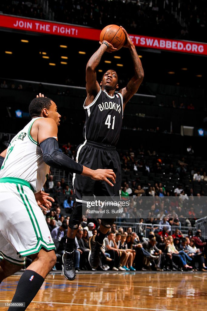 <a gi-track='captionPersonalityLinkClicked' href=/galleries/search?phrase=Tyshawn+Taylor&family=editorial&specificpeople=5619738 ng-click='$event.stopPropagation()'>Tyshawn Taylor</a> #41 of the Brooklyn Nets shoots against the Boston Celtics during a pre-season game on October 18, 2012 at the Barclays Center in the Brooklyn borough of New York City.