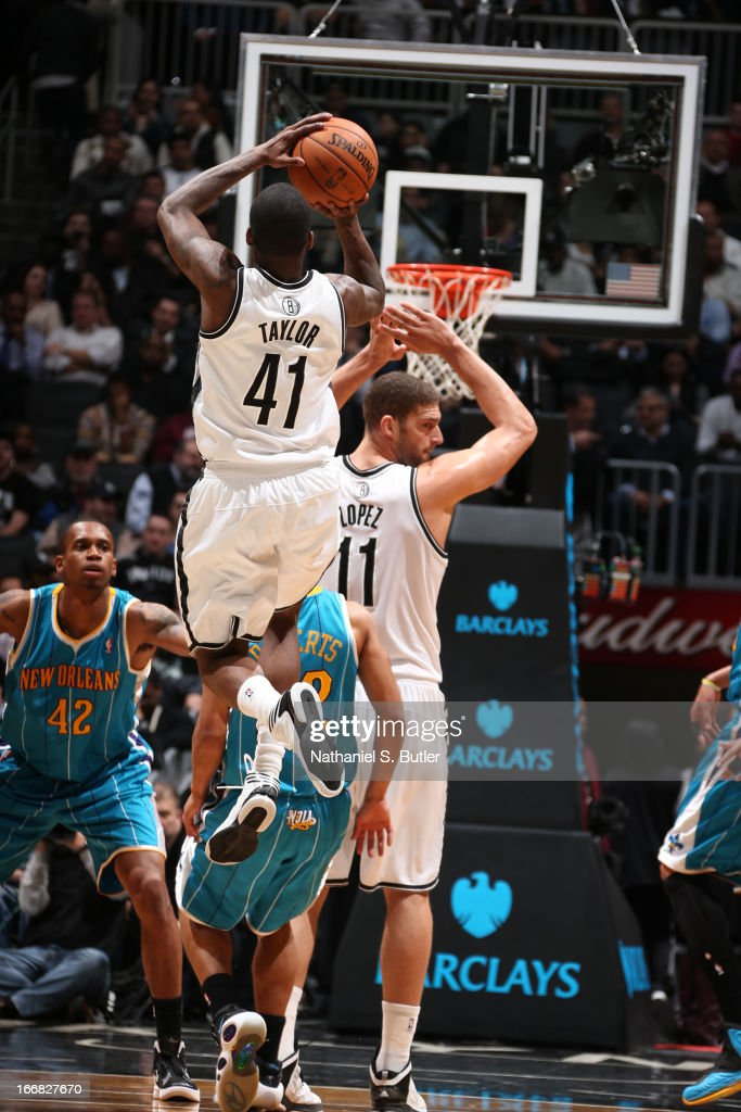 <a gi-track='captionPersonalityLinkClicked' href=/galleries/search?phrase=Tyshawn+Taylor&family=editorial&specificpeople=5619738 ng-click='$event.stopPropagation()'>Tyshawn Taylor</a> #41 of the Brooklyn Nets shoots against the New Orleans Hornets on March 12, 2013 at the Barclays Center in the Brooklyn borough of New York City.