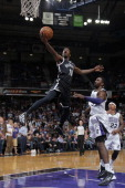 Tyshawn Taylor of the Brooklyn Nets takes the ball to the basket past Patrick Patterson of the Sacramento Kings at Sleep Train Arena on November 13...