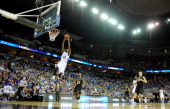 Tyshawn Taylor of the Kansas Jayhawks dunks in the second half against the Purdue Boilermakers during the third round of the 2012 NCAA Men's...