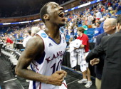 Tyshawn Taylor of the Kansas Jayhawks jogs off the court after defeating the Illinois Fighting Illini 5973 in the third round of the 2011 NCAA men's...