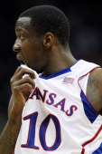 Tyshawn Taylor of the Kansas Jayhawks reacts in the first half against the Baylor Bears during the semifinals of the 2012 Big 12 Men's Basketball...