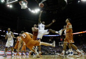 Tyshawn Taylor of the Kansas Jayhawks throws up a shot against the Texas Longhorns during the 2011 Phillips 66 Big 12 Men's Basketball Tournament...