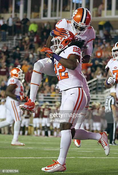 Tyshon Dye of the Clemson Tigers celebrates his touchdown with Deon Cain in second half against the Boston College Eagles at Alumni Stadium on...