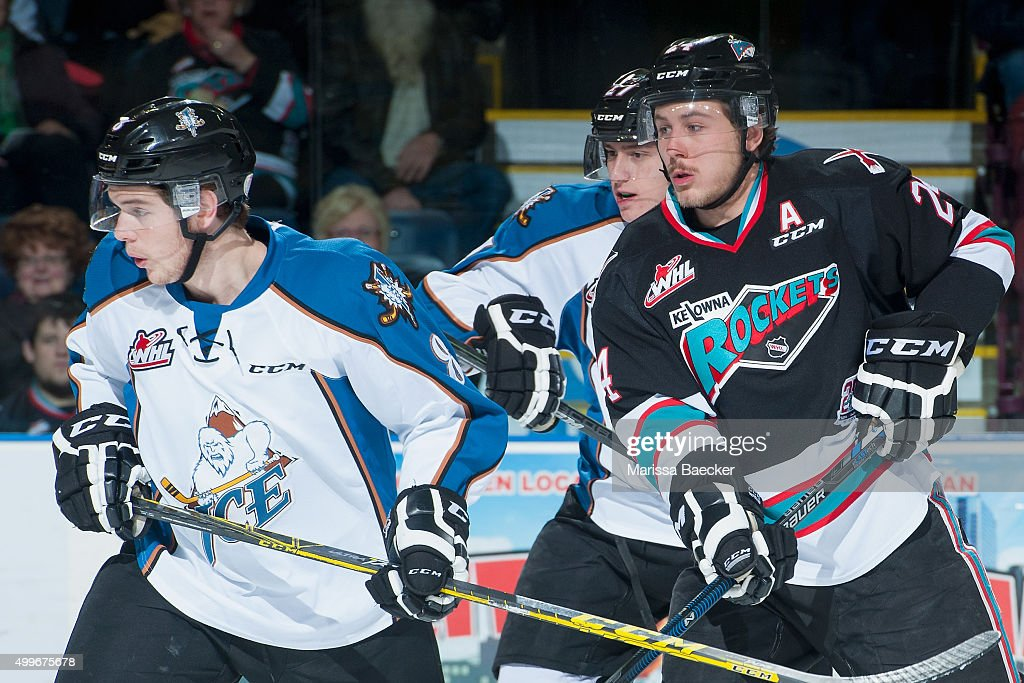 Tyson Baillie #24 of Kelowna Rockets stick checks Dallas Hines #8 of Kootenay Ice during first period on December 2, 2015 at Prospera Place in Kelowna, British Columbia, Canada.