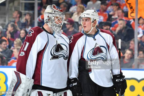 Tyson Barrie and Calvin Pickard of the Colorado Avalanche discuss the play during the game against the Edmonton Oilers on March 25 2017 at Rogers...