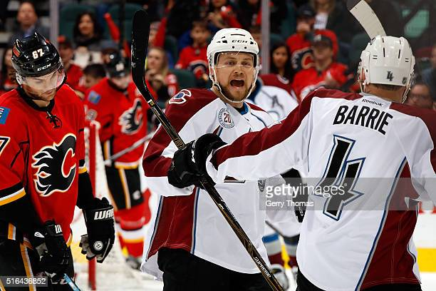 Tyson Barrie and teammates of the Colorado Avalanche celebrate a goal against the Calgary Flames during an NHL game at Scotiabank Saddledome on March...