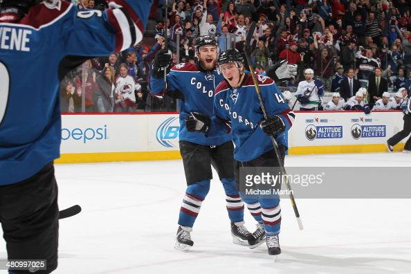Tyson Barrie of the Colorado Avalanche celebrates after scoring the game winning goal against the Vancouver Canucks at the Pepsi Center on March 27...