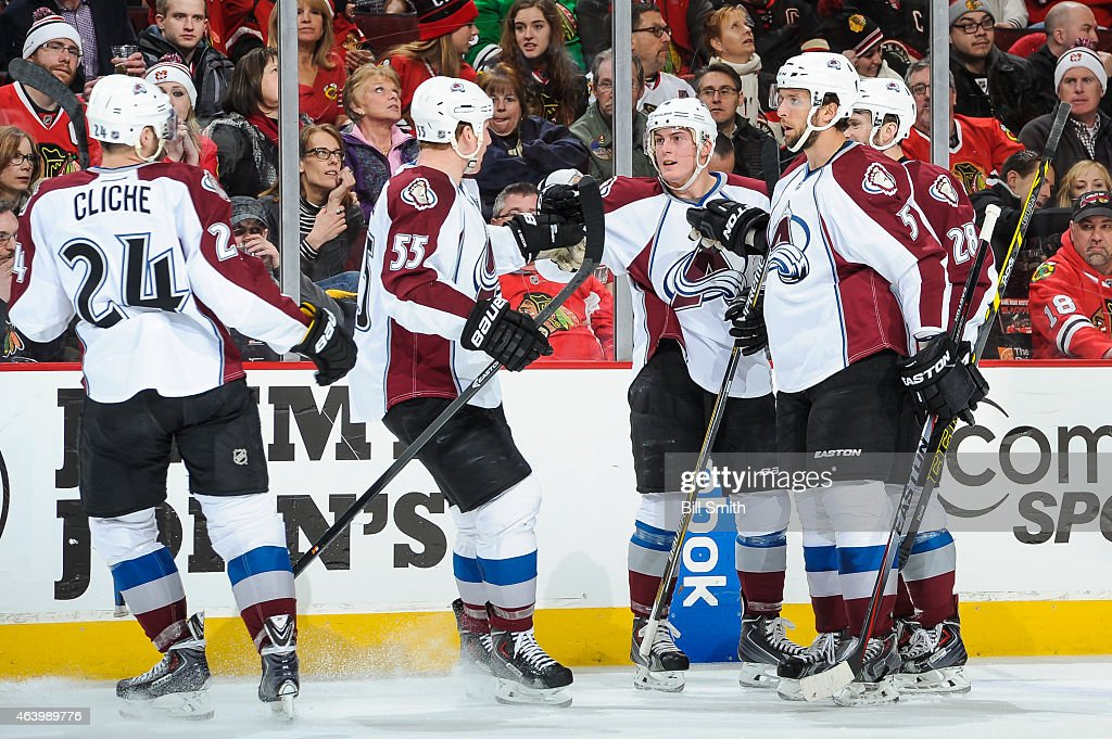<a gi-track='captionPersonalityLinkClicked' href=/galleries/search?phrase=Tyson+Barrie&family=editorial&specificpeople=4669265 ng-click='$event.stopPropagation()'>Tyson Barrie</a> #4 of the Colorado Avalanche celebrates with teammates, including <a gi-track='captionPersonalityLinkClicked' href=/galleries/search?phrase=Cody+McLeod&family=editorial&specificpeople=2242985 ng-click='$event.stopPropagation()'>Cody McLeod</a> #55 and <a gi-track='captionPersonalityLinkClicked' href=/galleries/search?phrase=Nate+Guenin&family=editorial&specificpeople=3948510 ng-click='$event.stopPropagation()'>Nate Guenin</a> #5, after scoring in the first period against the Chicago Blackhawks during the NHL game at the United Center on February 20, 2015 in Chicago, Illinois.