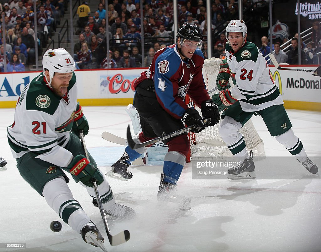 Tyson Barrie of the Colorado Avalanche clears the puck away from Matt Cooke and Kyle Brodziak of the Minnesota Wild in Game Two of the First Round of...