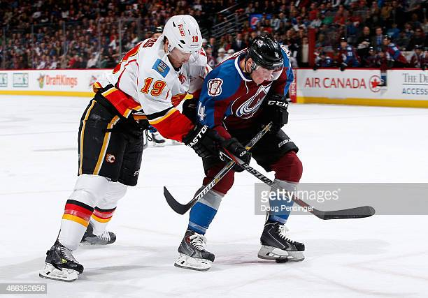 Tyson Barrie of the Colorado Avalanche controls the puck against David Jones of the Calgary Flames at Pepsi Center on March 14 2015 in Denver Colorado