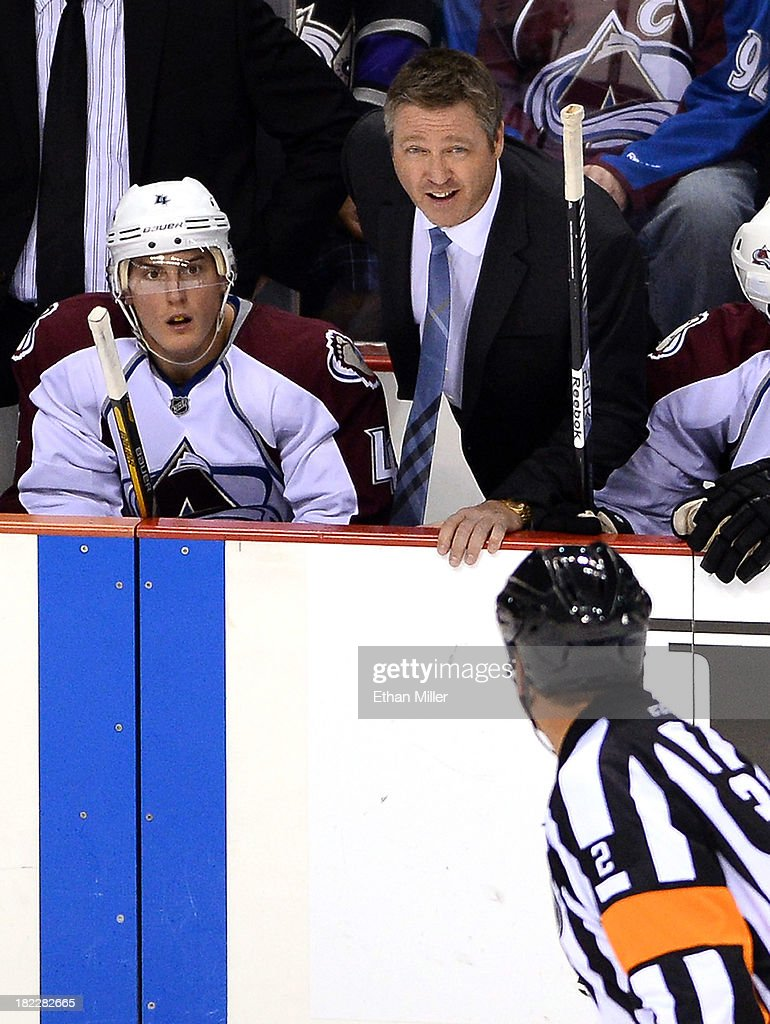 <a gi-track='captionPersonalityLinkClicked' href=/galleries/search?phrase=Tyson+Barrie&family=editorial&specificpeople=4669265 ng-click='$event.stopPropagation()'>Tyson Barrie</a> #4 of the Colorado Avalanche looks on as head coach <a gi-track='captionPersonalityLinkClicked' href=/galleries/search?phrase=Patrick+Roy&family=editorial&specificpeople=204512 ng-click='$event.stopPropagation()'>Patrick Roy</a> talks to a referee during a timeout in their preseason game against the Los Angeles Kings at the MGM Grand Garden Arena on September 28, 2013 in Las Vegas, Nevada. Colorado won 3-2.